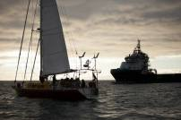 The sailing vessel Tiama in front of the drill support vessel the Hart Tide. The Oil Free Otago flotilla is a coalition of Otago residents who oppose deep sea drilling off our coast. Photo by Nick Tapp - nicktappvideo.com
