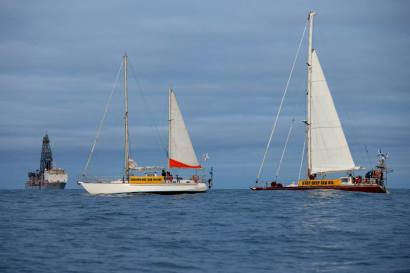 The sailing vessels Erewhon and Tiama sail in front of the drill ship the Noble Bob Douglas. The Oil Free Otago flotilla is a coalition of Otago residents who oppose deep sea drilling off our coast. Photo by Nick Tapp - nicktappvideo.com