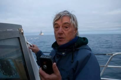 Professor Bob Lloyd, director of Energy Studies at the University of Otago, sends a message to the drill ship the Noble Bob Douglas explaining his opposition to deep sea drilling. The Oil Free Otago flotilla is a coalition of Otago residents who oppose deep sea drilling off our coast. Photo by Nick Tapp - nicktappvideo.com