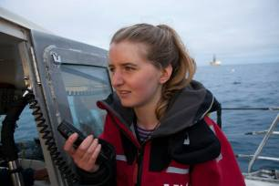 Torea Scott-Fyffe, local youth, sends a message to the drill ship the Noble Bob Douglas explaining her opposition to deep sea drilling. The Oil Free Otago flotilla is a coalition of Otago residents who oppose deep sea drilling off our coast. Photo by Nick Tapp - nicktappvideo.com