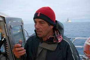 Brendan Flack, Tangata Tiaki, sends a message to the drill ship the Noble Bob Douglas explaining his opposition to deep sea drilling. The Oil Free Otago flotilla is a coalition of Otago residents who oppose deep sea drilling off our coast. Photo by Nick Tapp - nicktappvideo.com